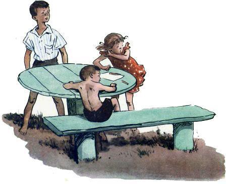 дети за столом на лавочке