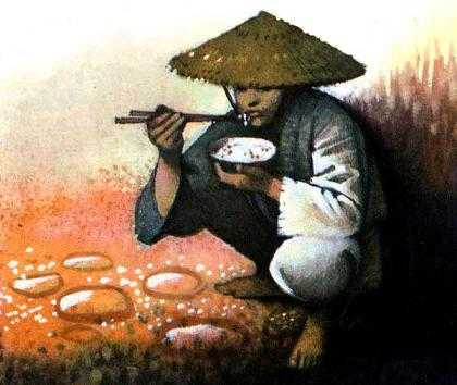 юноша Ванг-Сяо ест рис