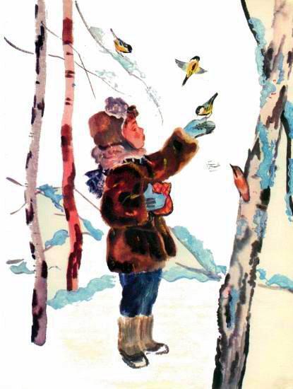 мальчик зимой кормит синиц